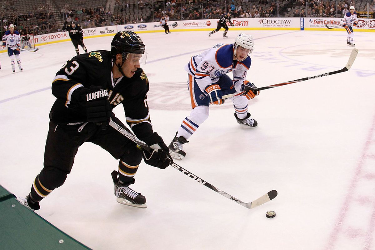 DALLAS, TX - NOVEMBER 21:  Mike Ribeiro #63 of the Dallas Stars skates the puck past Ryan Nugent-Hopkins #93 of the Edmonton Oilers at American Airlines Center on November 21, 2011 in Dallas, Texas.  (Photo by Ronald Martinez/Getty Images)
