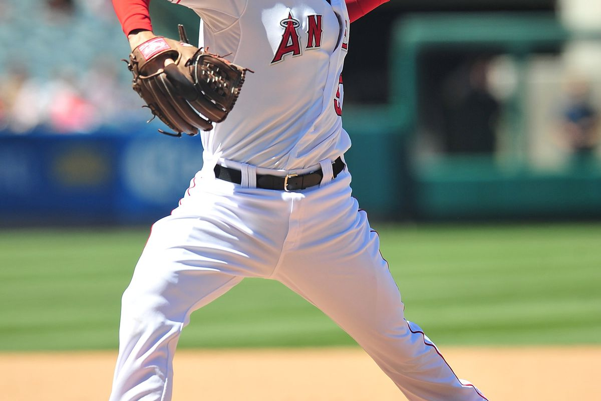 July 25, 2012; Anaheim, CA, USA; Los Angeles Angels relief pitcher Scott Downs (37) pitches in the eighth inning against the Kansas City Royals at Angel Stadium. Mandatory Credit: Gary A. Vasquez-US PRESSWIRE