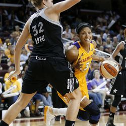 Los Angeles Sparks' Candace Parker, right, is defended by San Antonio Silver Stars' Jayne Appel during Game 1 of a WNBA basketball first-round playoff series, in Los Angeles on Thursday, Sept. 27, 2012.
