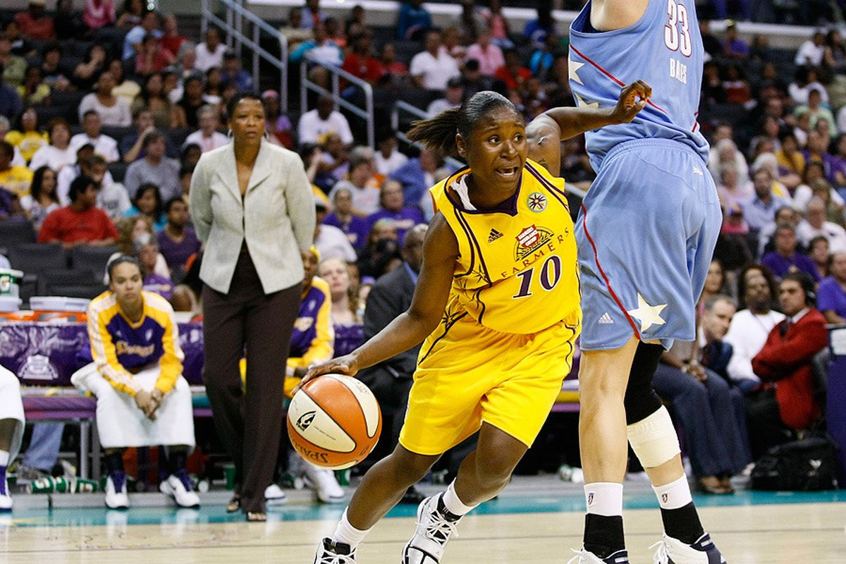 """Andrea Riley driving the ball during her rookie season in 2010 with the Los Angeles Sparks. Photo by Craig Bennett, <a href=""""http://www.swishappeal.com/"""" target=""""new"""">Swish Appeal</a>"""