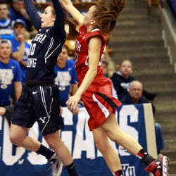 BYU's Stephanie Rovetti shoots as Utah's Danielle Rodriguez reaches for the ball during a women's basketball game at the Marriott Center in Provo on Saturday, Dec. 14, 2013. Utah won in double overtime 82-74.