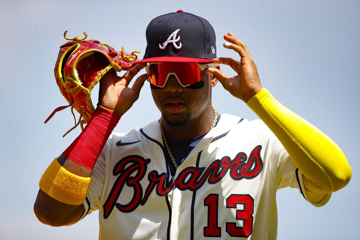 Ronald Acuna Jr. #13 of the Atlanta Braves reacts in the seventh inning of an MLB game against the Pittsburgh Pirates at Truist Park on May 23, 2021 in Atlanta, Georgia.