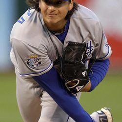 Kansas City Royals' Luis Mendoza works against the Oakland Athletics during the first inning of a baseball game Monday, April 9, 2012, in Oakland, Calif.