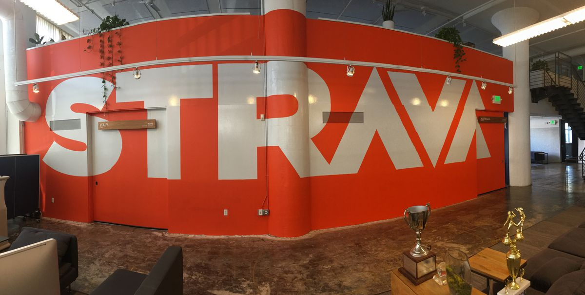 The Strava logo is painted across the wall at the company's San Francisco headquarters.