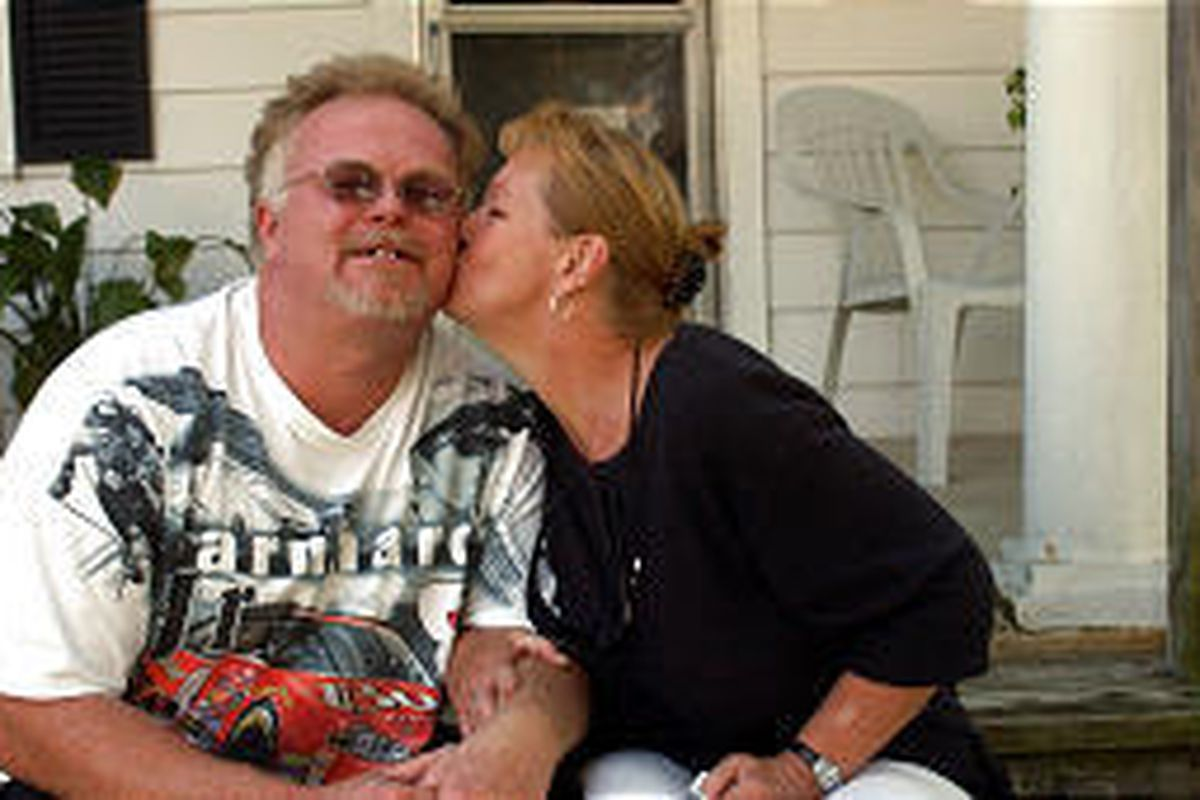 Kirk Bloodsworth, left, is kissed by his wife after hearing another man was charged with slaying that sent him to death row.