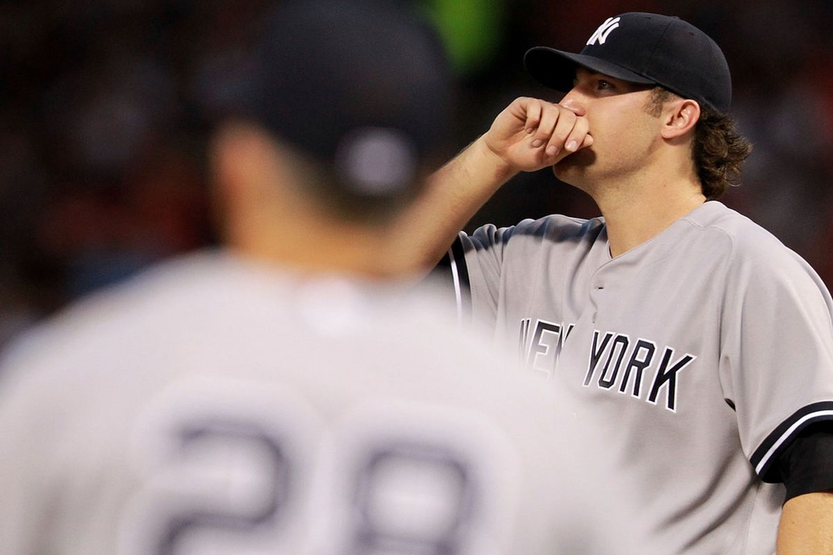 ARLINGTON, TX - APRIL 25:  Phil Hughes #65 of the New York Yankees reacts as he leaves the game against the Texas Rangers at Rangers Ballpark in Arlington on April 25, 2012 in Arlington, Texas.  (Photo by Ronald Martinez/Getty Images)
