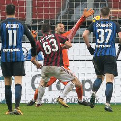 Patrick Cutrone of AC Milan (C) scores the opening goal during the TIM Cup match between AC Milan and FC Internazionale at Stadio Giuseppe Meazza on December 27, 2017 in Milan, Italy.
