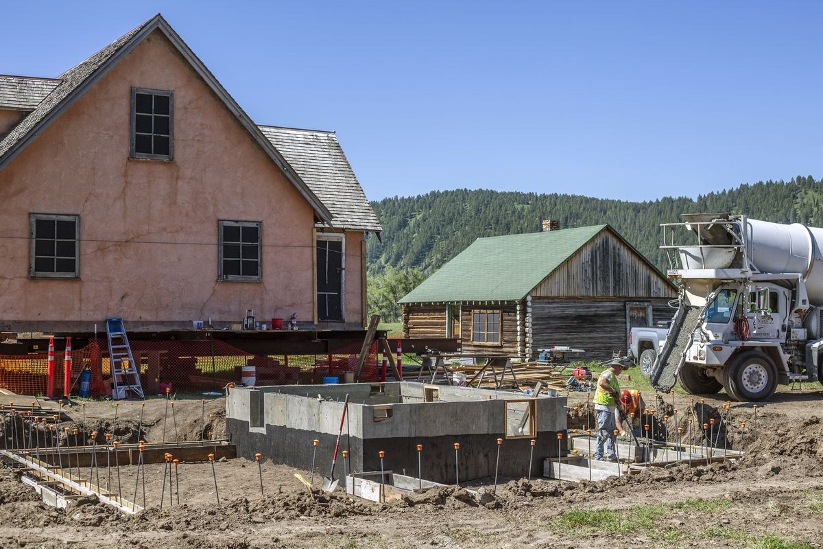 Workers pour a new foundation for the historic Pink House on Mormon Row in Grand Teton National Park.