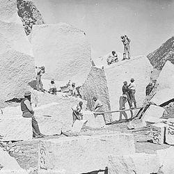Men in a granite quarry working on stones to be used in the Salt Lake Temple in 1872. The temple took 40 years to complete.