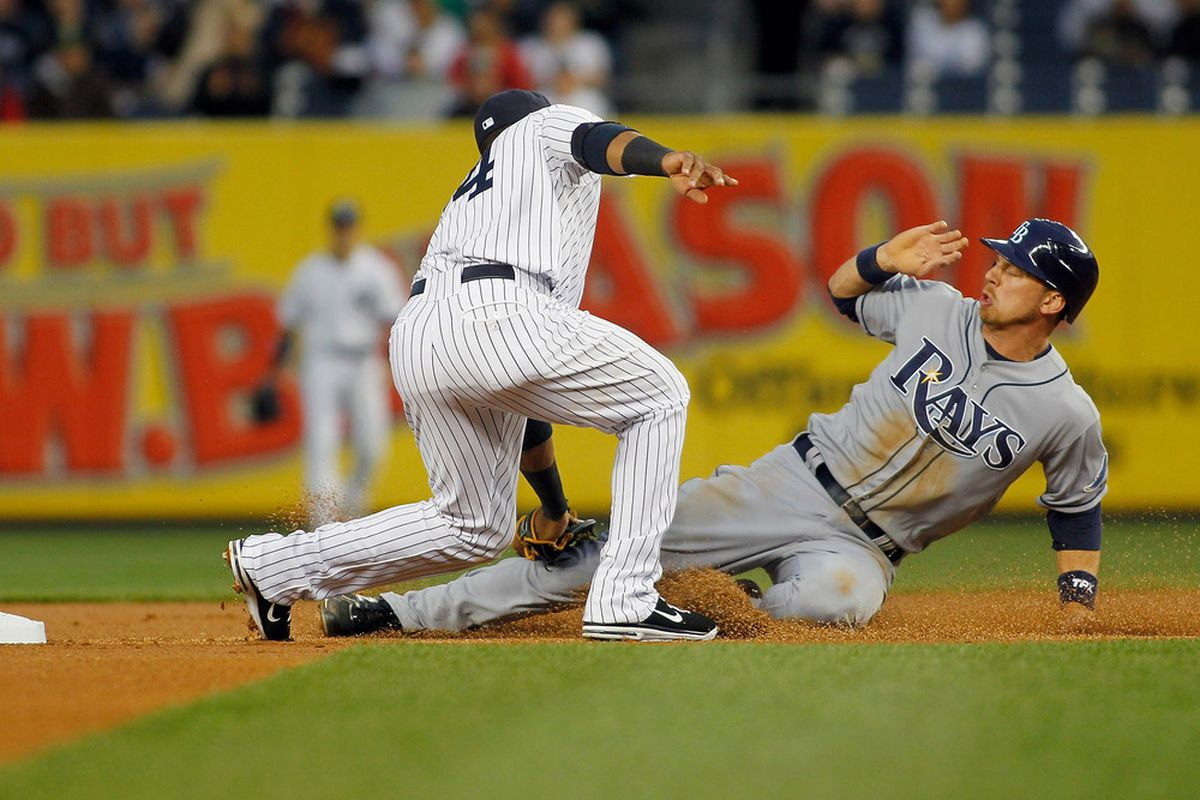 NEW YORK, NY - MAY 08: Ben Zobrist #18 of the Tampa Bay Rays is tagged out trying to steal second by Robinson Cano #24 of the New York Yankees at Yankee Stadium on May 8, 2012 in the Bronx borough of New York City.  (Photo by Mike Stobe/Getty Images)