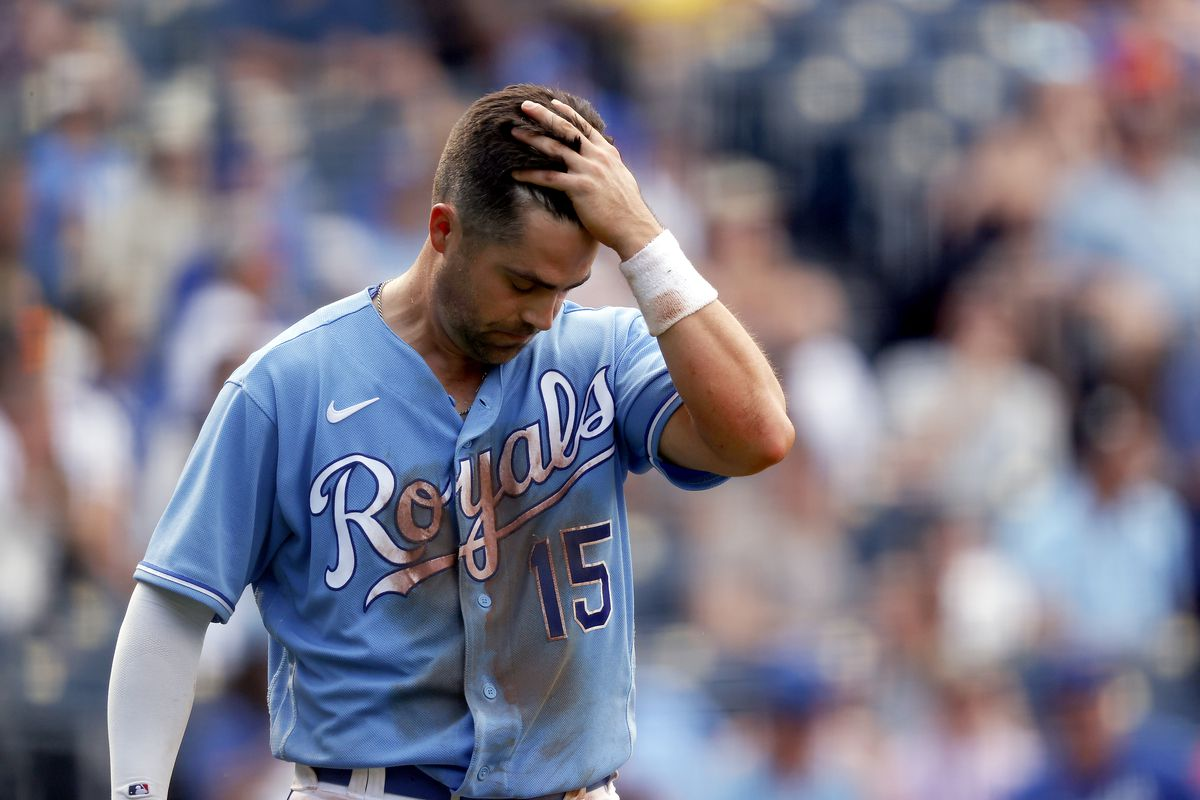 Whit Merrifield #15 of the Kansas City Royals reacts after striking out during the game against the Boston Red Sox at Kauffman Stadium on June 19, 2021 in Kansas City, Missouri.