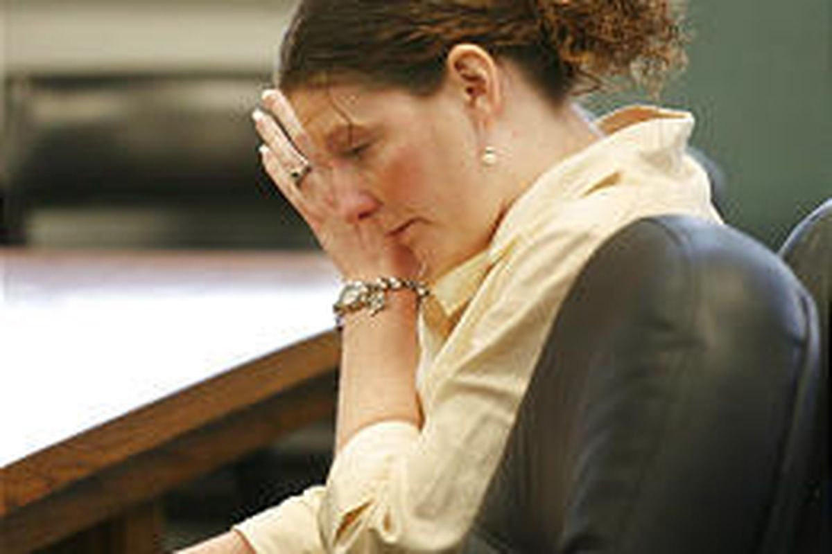 Jennete Killpack wipes away a tear during sentencing.