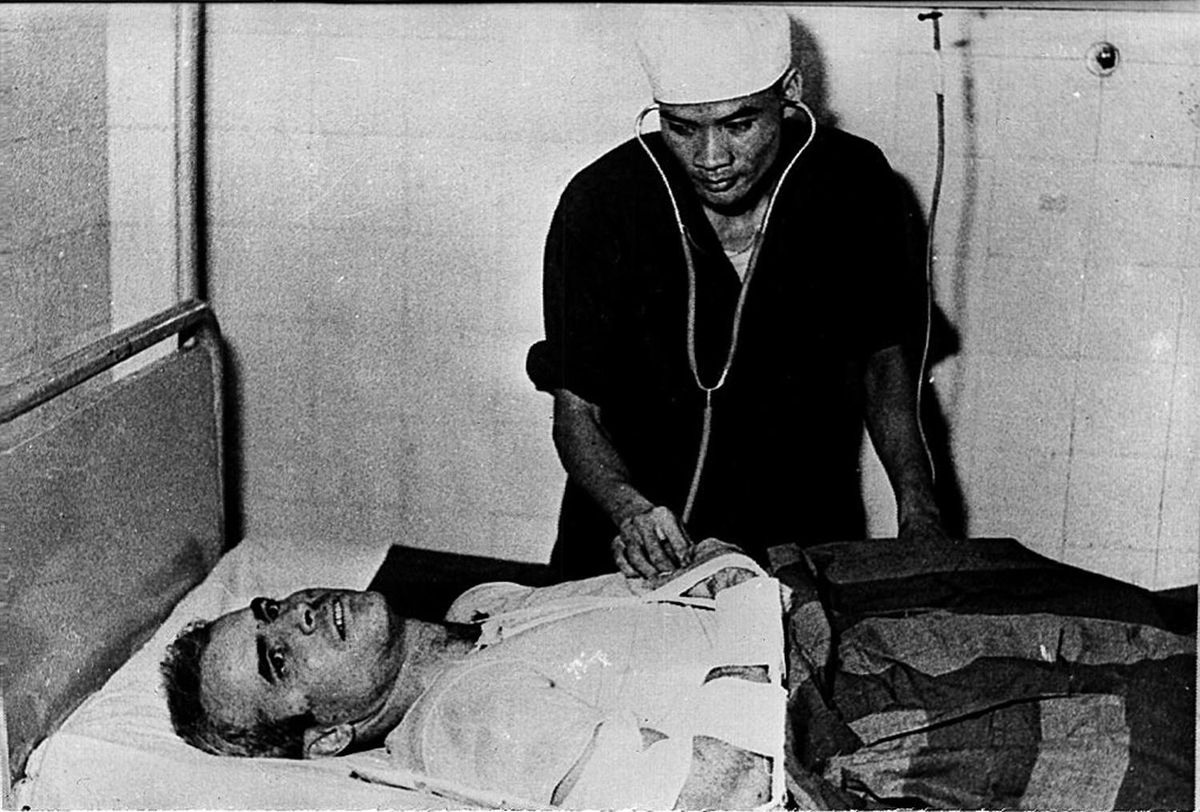 A photo taken in 1967 shows US Navy pilot John McCain being examined by a North Vietnamese doctor.