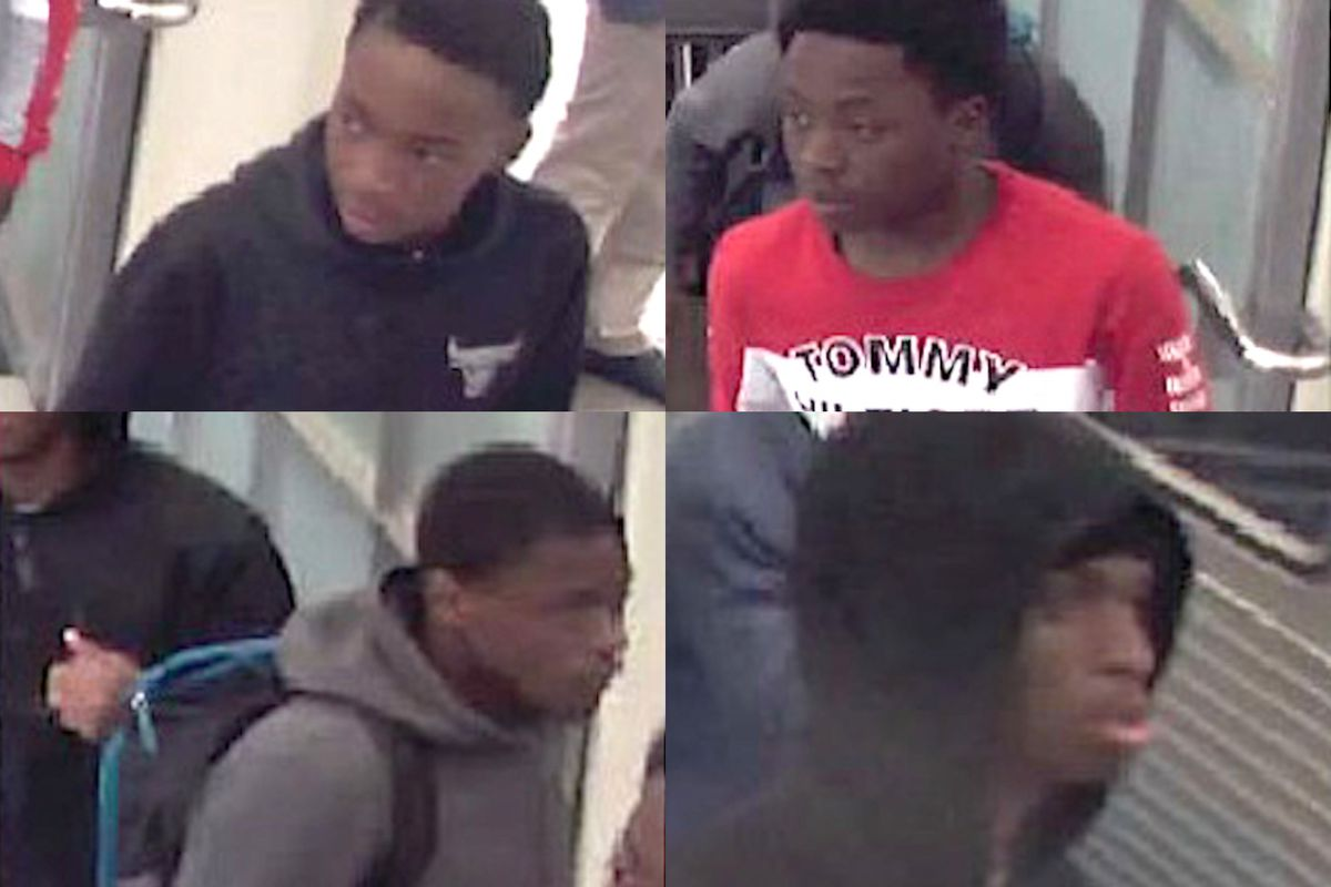 Four males are wanted for robbing people on the Red Line.