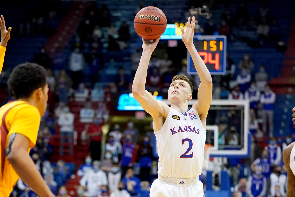 Kansas Jayhawks guard Christian Braun shoots a three point basket during the first half against the Iowa State Cyclones at Allen Fieldhouse.