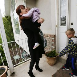 Patricia Abbott Lammi gives her daughter Juliet a hug as she drops her kids, Juliet and Luke, off at daycare on Tuesday, May 2, 2017. Patricia and her husband Phillip juggle their work schedules to make things work with their kids.