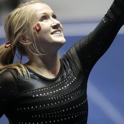 Utah's Kyndal Robarts performs on the floor during the NCAA Salt Lake Regional Gymnastics Saturday, April 7, 2012 in Salt Lake City. Robarts tied for first place in the exercise.