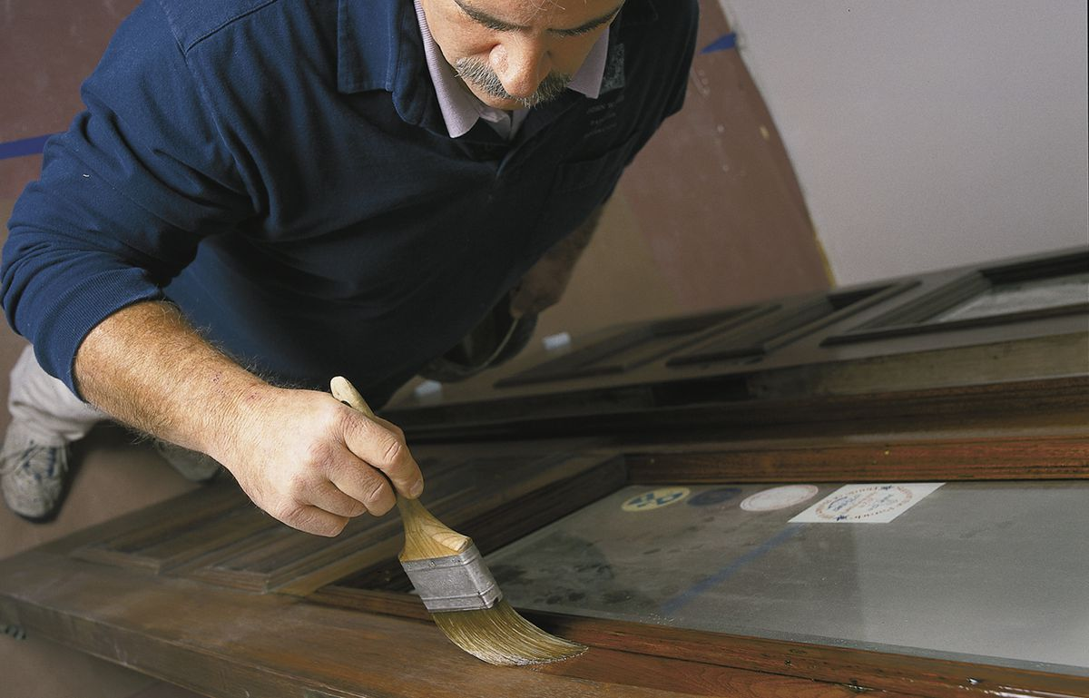 """<p>""""When a clear finish is showing off the beauty of mahogony, white oak, walnut, or antique pine, it's definitely worth the effort,"""" says painter John Dee, who applied three coats to the entry doors at This Old House's Charlestown project.</p>"""