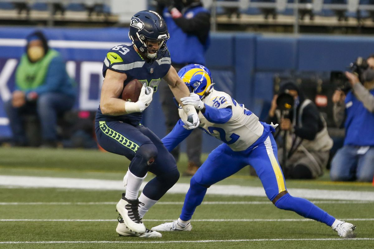 Seattle Seahawks tight end Will Dissly (89) runs for yards after the catch against Los Angeles Rams strong safety Jordan Fuller (32) during the third quarter at Lumen Field.