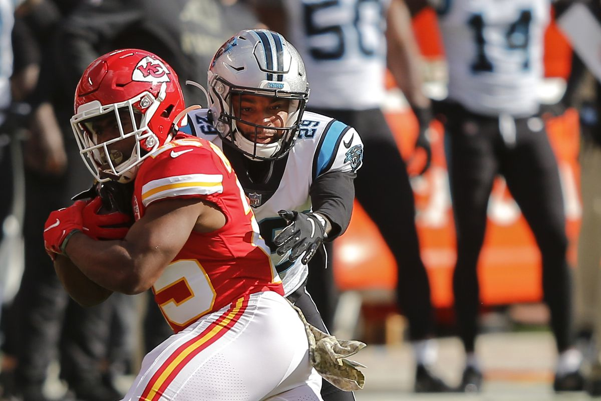 Corn Elder #29 of the Carolina Panthers tackles Clyde Edwards-Helaire #25 of the Kansas City Chiefs on a first quarter run at Arrowhead Stadium on November 8, 2020 in Kansas City, Missouri.