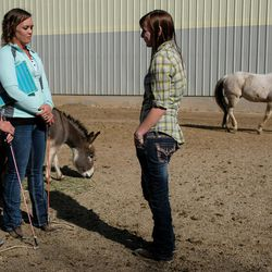 Abby Petchinsky, 21, of Mt. Pleasant, right, talks with Jolene Green, LCSW, left, and Brittani Frade, CMHCi, second from left, at The Barn in South Jordan on Friday, March 17, 2017.