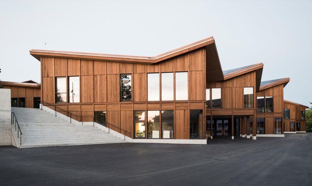 Wood facade of school with windows
