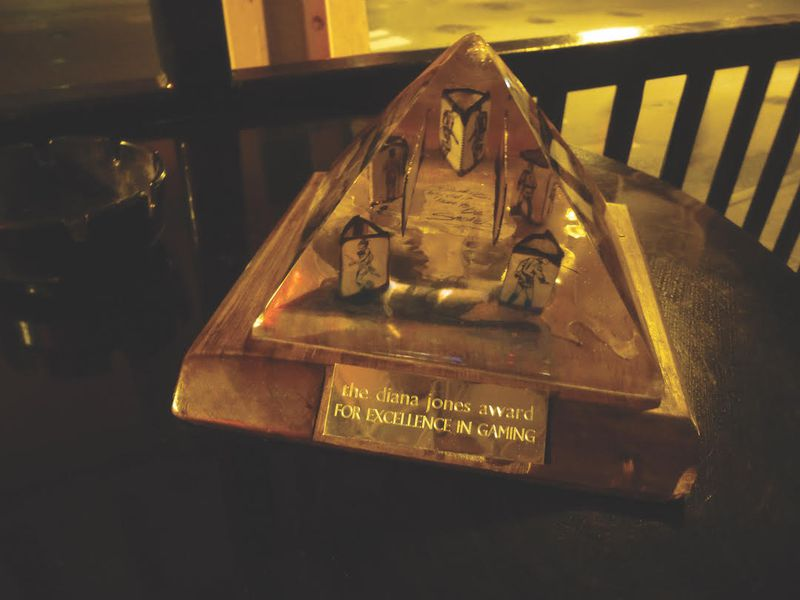 A fuzzy picture of the Diana Jones Award next to an ashtray, taken no doubt in some Indianapolis bar.