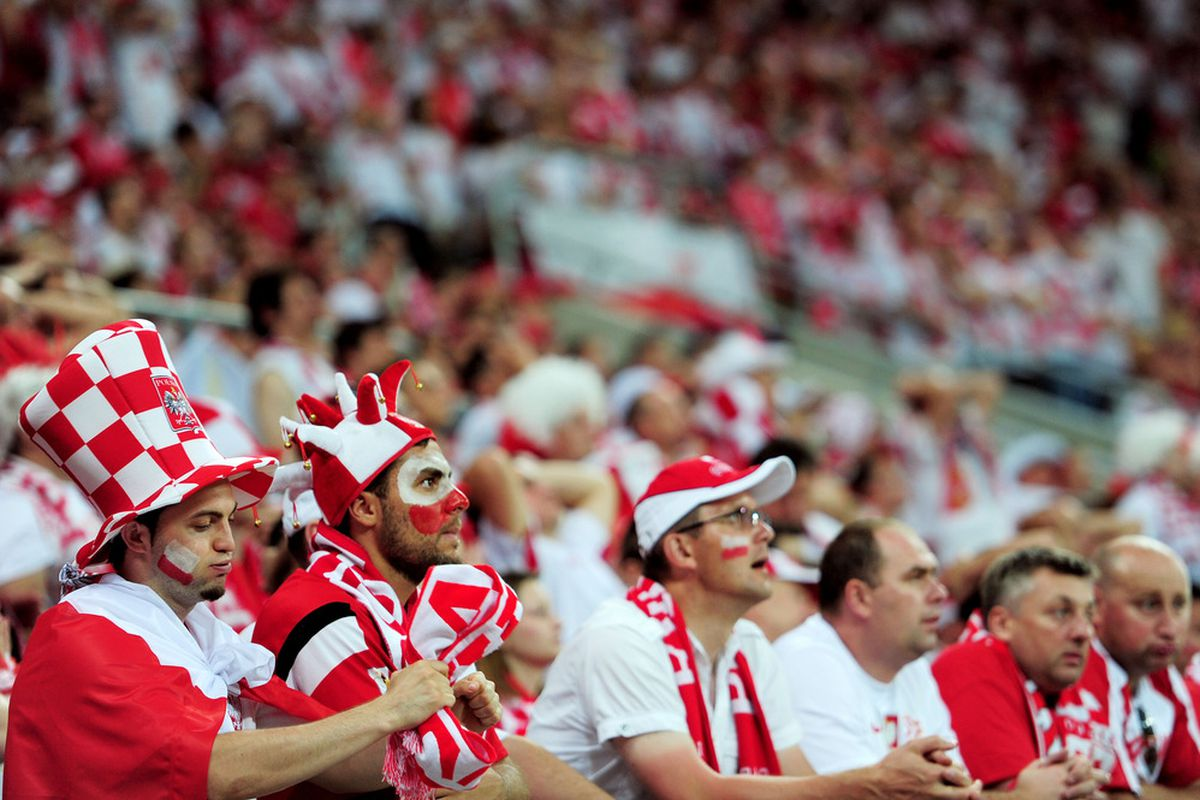 WROCLAW, POLAND - JUNE 16:  Poland fans look on during the UEFA EURO 2012 group A match between Czech Republic and Poland at The Municipal Stadium on June 16, 2012 in Wroclaw, Poland.  (Photo by Jamie McDonald/Getty Images)