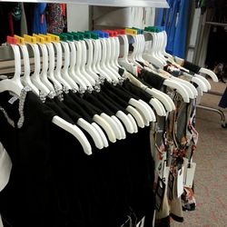 Peplum tanks ($39.99) in Floral and Black abound.