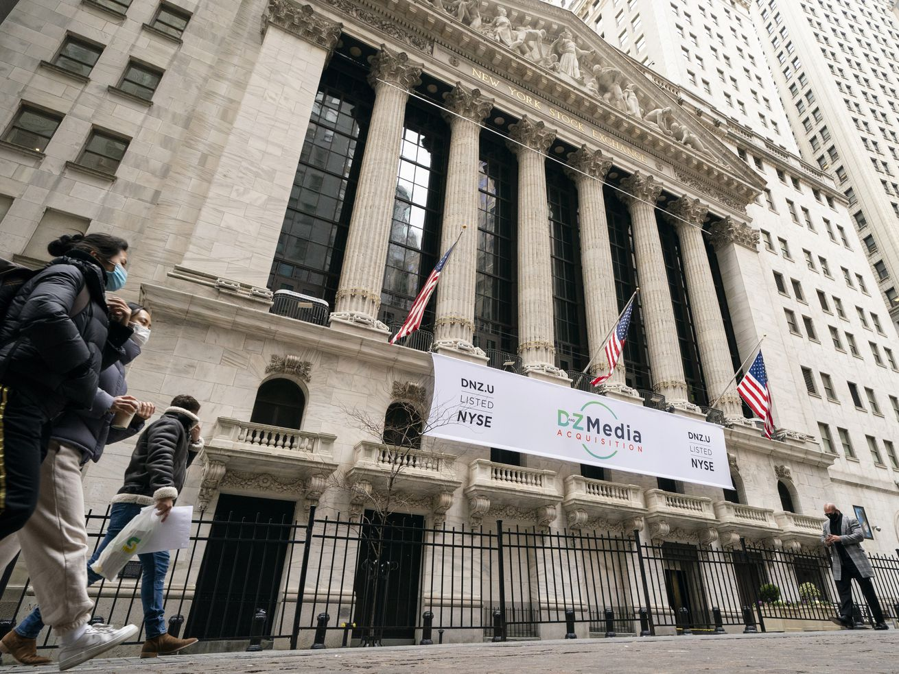 In this Jan. 27, 2021 file photo, pedestrians pass the New York Stock Exchange in New York. Stocks were solidly lower in early trading Tuesday, May 4, dragged down by banks and big technology companies like Apple and Google.