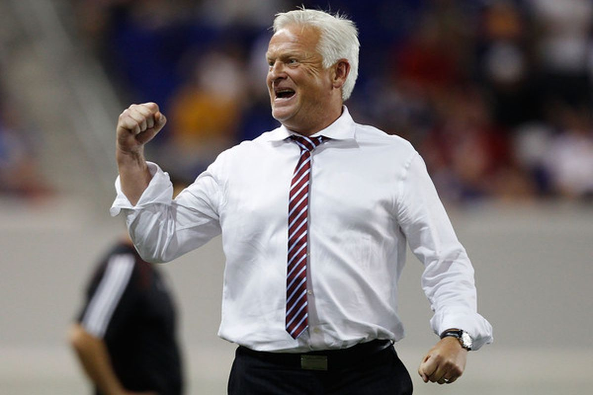 HARRISON NJ - AUGUST 11:  Hans Backe of the New York Red Bulls celebrates after defeating Toronto FC 1-0 on August 11 2010 at Red Bull Arena in Harrison New Jersey.  (Photo by Mike Stobe/Getty Images for New York Red Bulls)