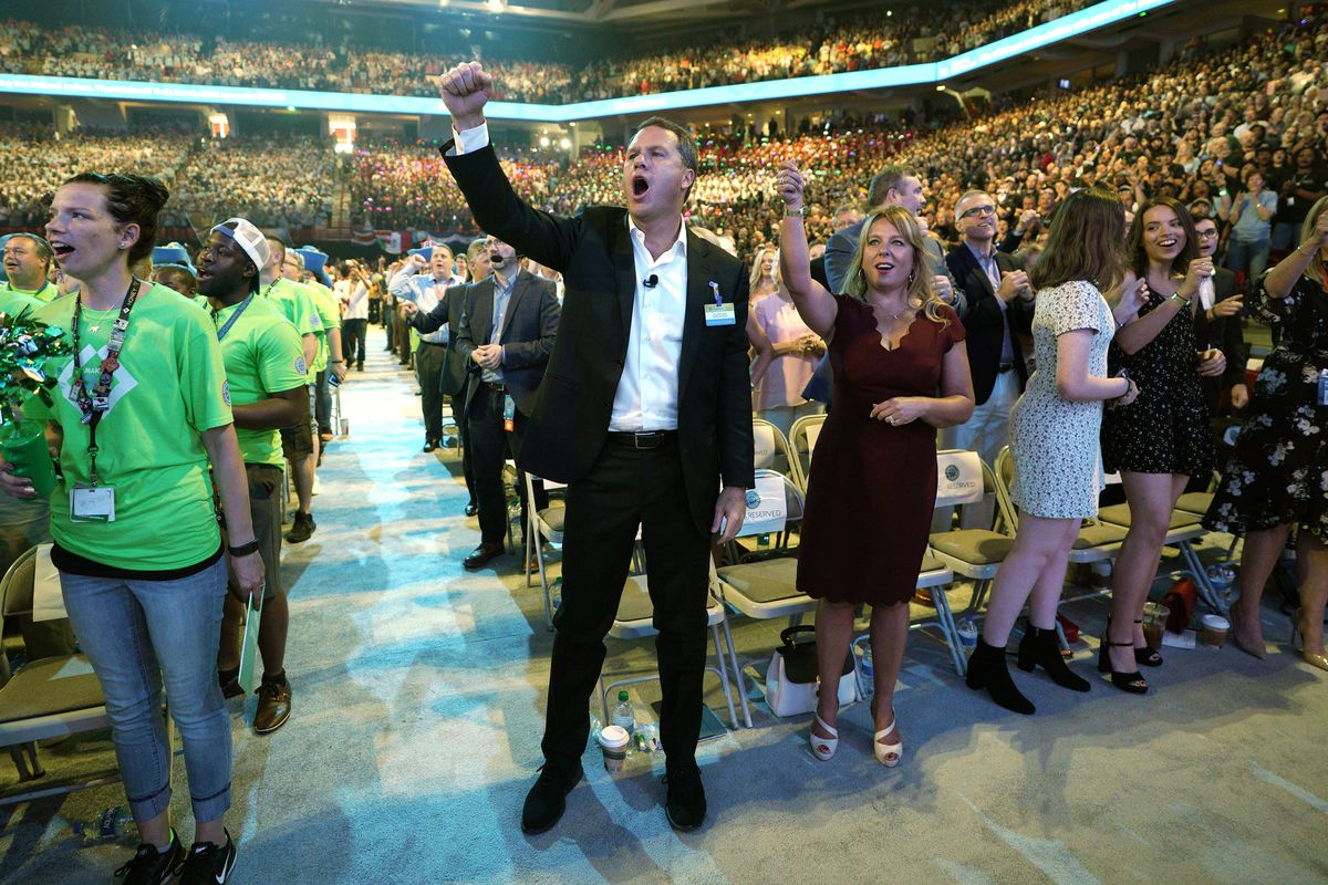 Doug McMillon, Walmart CEO, gives the Walmart cheer with wife Shelley during the annual shareholders meeting event on June 1, 2018 in Fayetteville, Arkansas.
