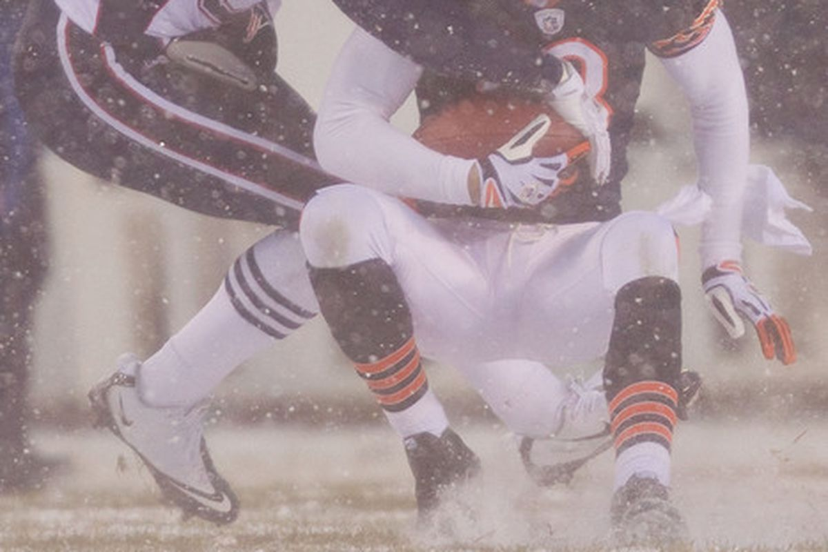 Kahlil Bell of the Chicago Bears is tackled by Devin McCourty of the New England Patriots at Soldier Field on December 12 2010 in Chicago Illinois.  The Patriots beat the Bears 36-7.  (Photo by Dilip Vishwanat/Getty Images)