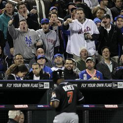 Fans react as Miami Marlins' Jose Reyes (7) returns to the dugout after flying out during the sixth inning of the baseball game against the Miami Marlins Tuesday, April 24, 2012, at Citi Field in New York.