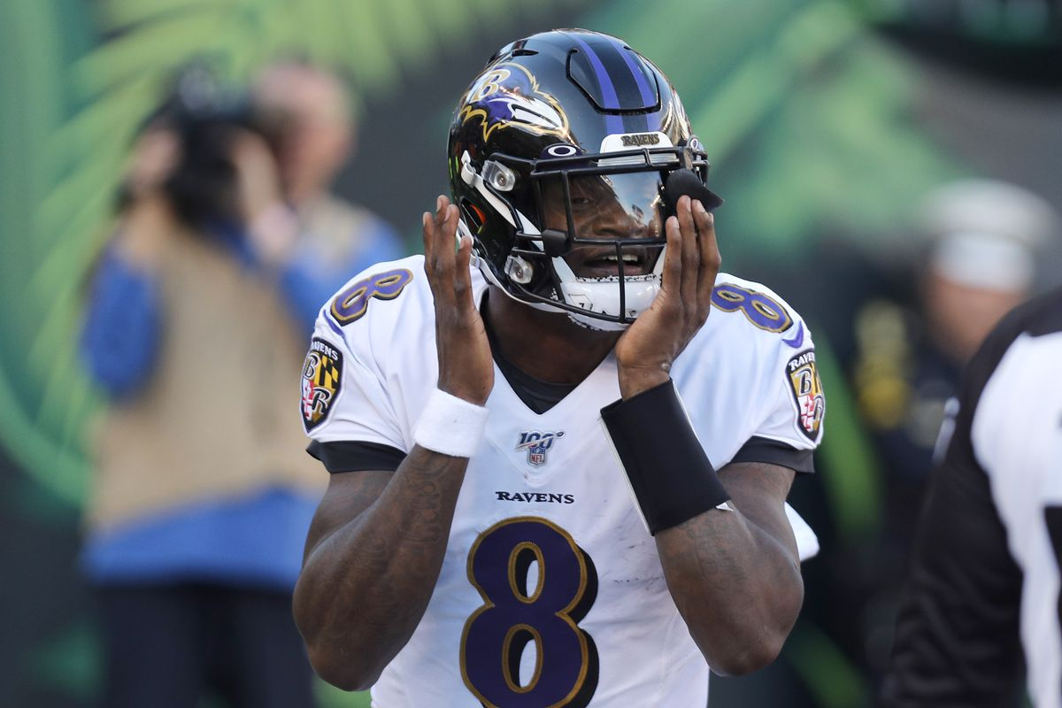 Baltimore Ravens quarterback Lamar Jackson reacts after scoring a touchdown against the Cincinnati Bengals during the second half at Paul Brown Stadium.