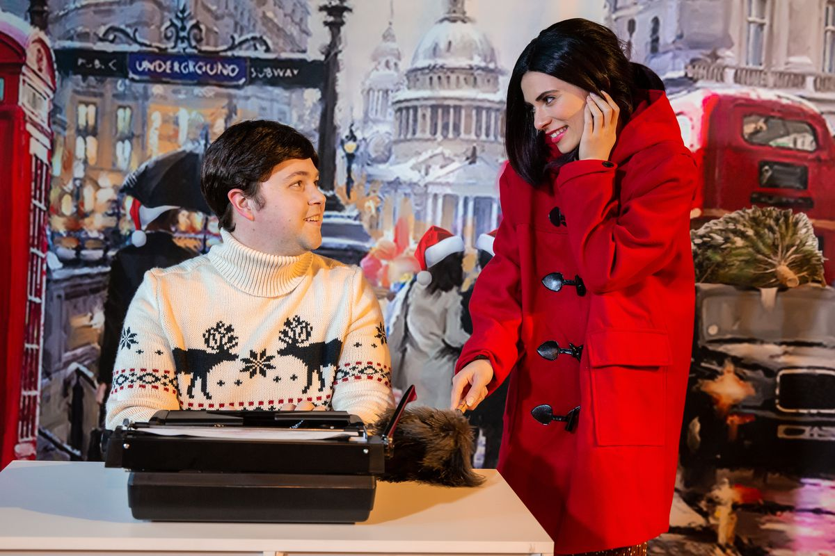 """James Parks and Kayla Catan are shown in a scene from the off-Broadway production of """"Love Actually? The Unauthorized Musical Parody."""""""
