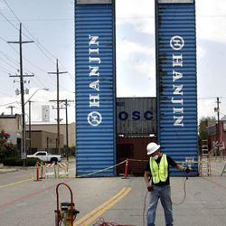 Shipping containers that are part of a stage are erected on 700 South near 400 West in the Granary District of Salt Lake City on Thursday, May 30, 2013. Starting mid-June, the street will become a festival site Thursday and Friday evenings and Saturdays through the summer. Shipping containers will line the center of the street where local artisans and entrepreneurs will sell their work. Live music, food and a beer garden will also be part of the festival. Jewelry designers, artists, clothing designers, a bicycle shop and a cupcake maker will occupy the shipping containers.