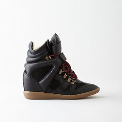 """Etoile Isabel Marant sneakers, <a href=""""http://www.stevenalan.com/F14_NA_F14_BK0024_14A012S.html?dwvar_F14__NA__F14__BK0024__14A012S_color=1560"""">$373</a> (was $830)"""