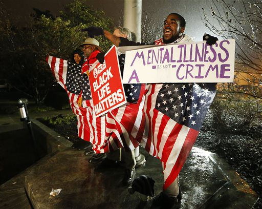 Protesters react outside the Dekalb County courthouse in Georgia on Thursday, Jan. 21, after it was announced that a grand jury decided to indict a police officer accused of shooting an unarmed naked man in March.   John Bazemore/AP