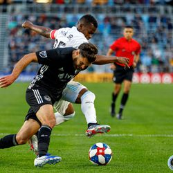 June 12, 2019 - Saint Paul, Minnesota, United States - Minnesota United forward Darwin Quintero (25) and Sporting KC defender Graham Zusi (8) battle for the ball during the US Open Cup match between Minnesota United and Sporting KC at Allianz Field.