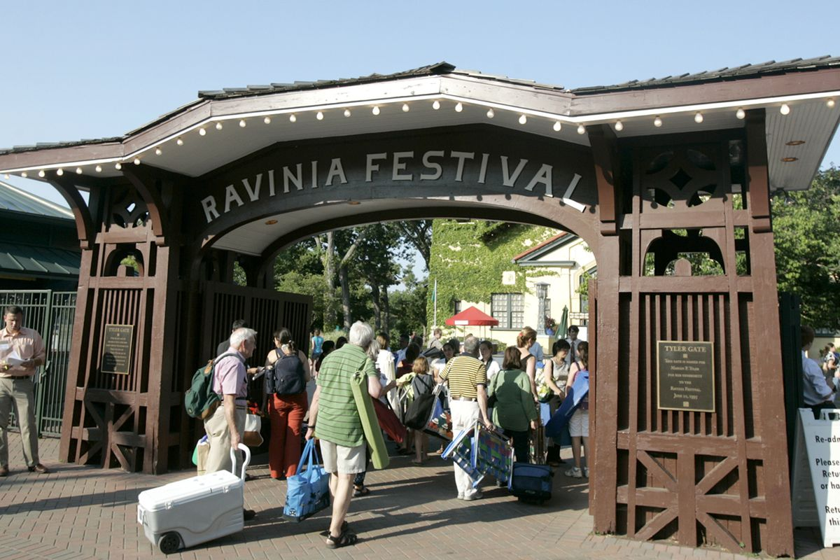 Patrons arrive at Ravinia's main gate for a summer concert.