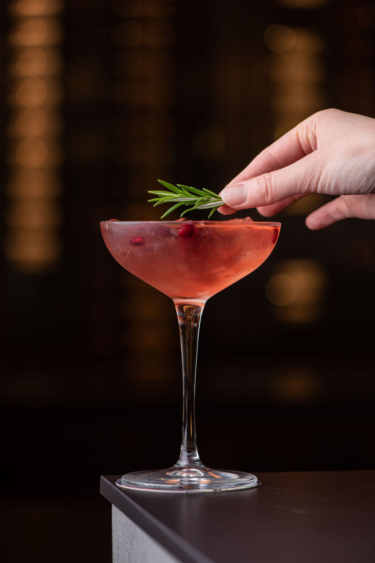 Red Punch cocktail with rosemary garnish at Daedo.