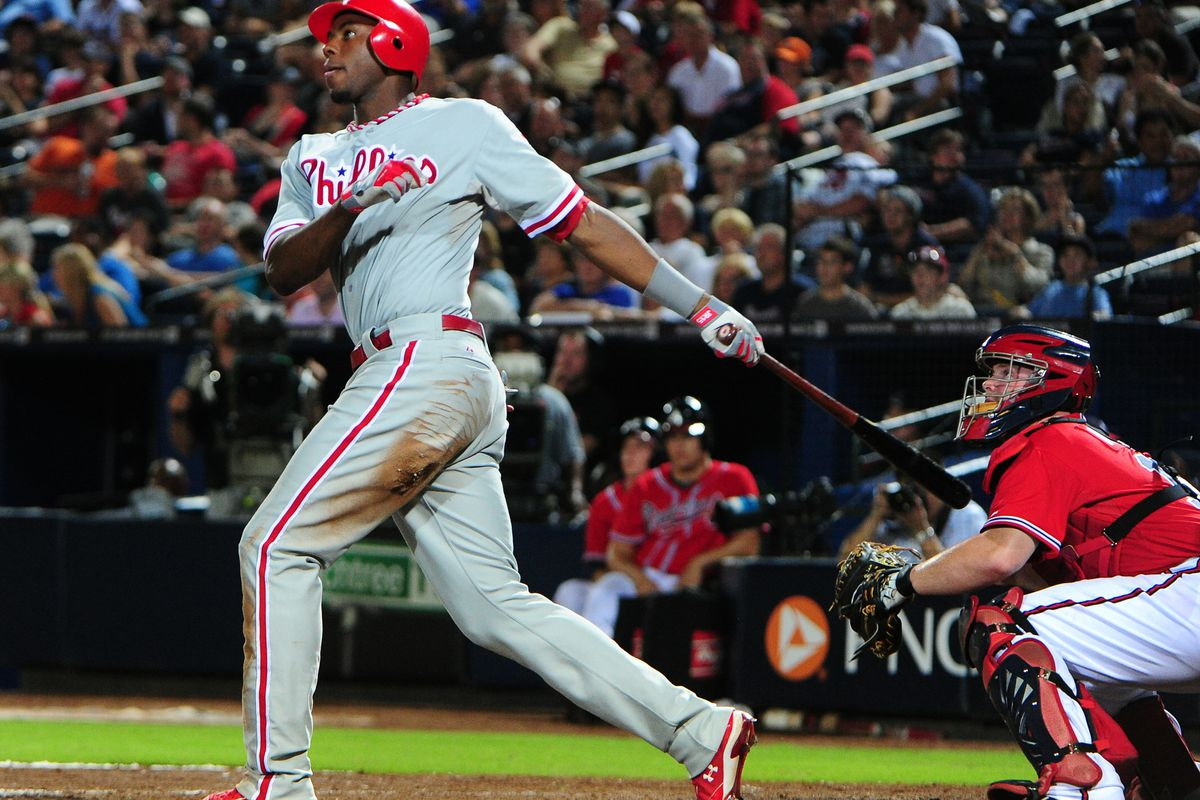 ATLANTA, GA - AUGUST 31: John Mayberry #15 of the Philadelphia Phillies hits a 10th inning home run against the Atlanta Braves at Turner Field on August 31, 2012 in Atlanta, Georgia. (Photo by Scott Cunningham/Getty Images)