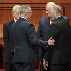 Members of the Quorum of the Twelve Apostles Elder Gerrit W. Gong, from left, Elder Ulisses Soares, Elder Dale G. Renlund and Elder Ronald A. Rasband talk prior to the Sunday morning session of the 189th Semiannual General Conference of The Church of Jesus Christ of Latter-day Saints in the Conference Center in Salt Lake City on Sunday, Oct. 6, 2019.
