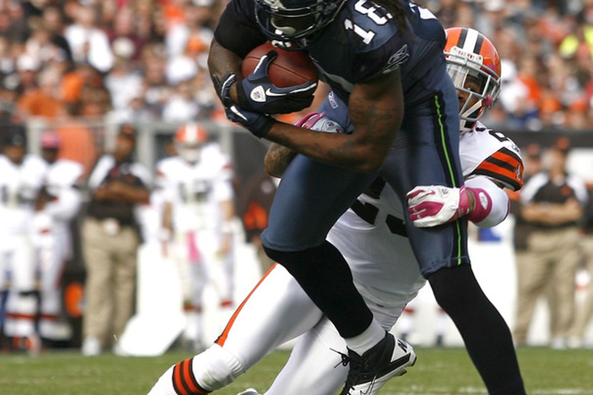 CLEVELAND, OH - OCTOBER 23:  Defensive back Joe Haden #23 of the Cleveland Browns tackles wide receiver Sidney Rice #18 the Seattle Seahawks at Cleveland Browns Stadium on October 23, 2011 in Cleveland, Ohio.  (Photo by Matt Sullivan/Getty Images)