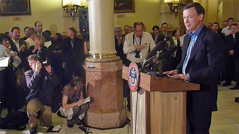 A somber Gov. John Hickenlooper announced he'll call a special session of the legislature to consider civil unions.