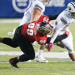 Brigham Young Cougars running back Lopini Katoa (4) carries the ball against the Western Kentucky Hilltoppers defense during an NCAA football game at LaVell Edwards Stadium in Provo on Saturday, Oct. 31, 2020.