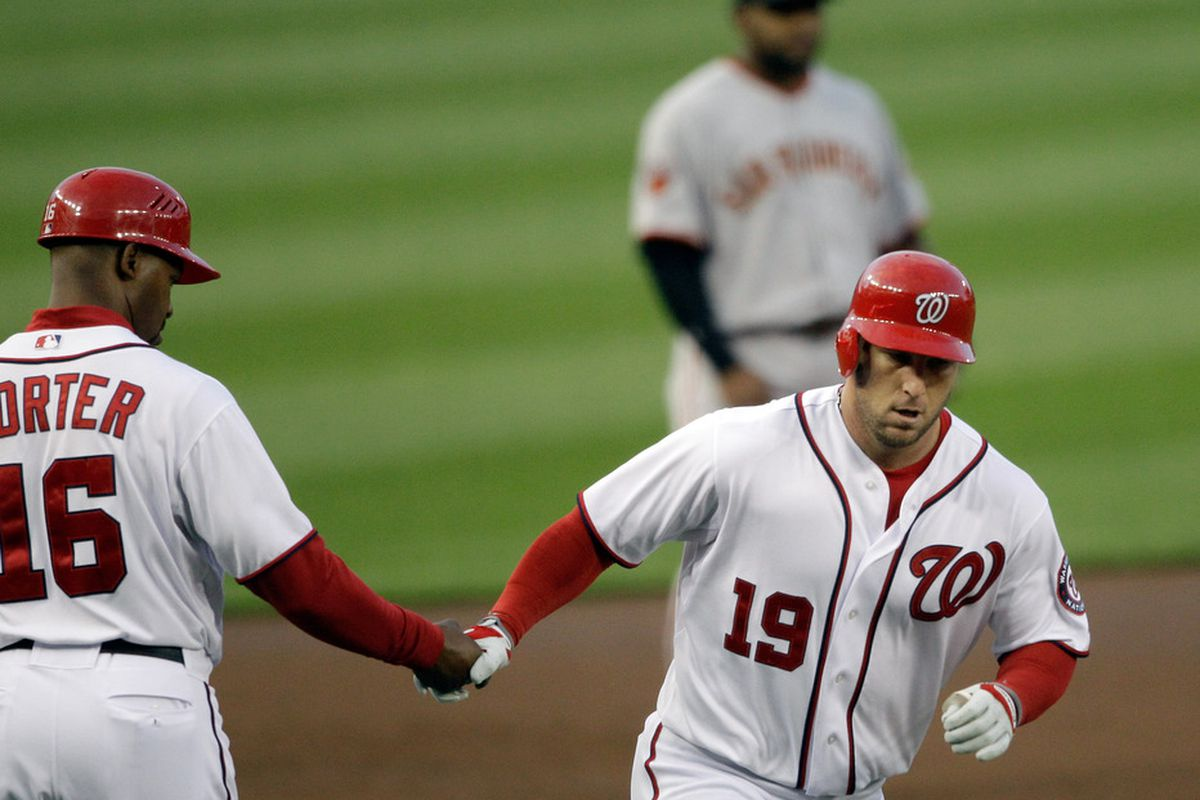 WASHINGTON, DC - APRIL 29:  Laynce Nix #19 of the Washington Nationals celebrates his two run homer with third base coach Bo Porter #16 during the second inning at Nationals Park on April 29, 2011 in Washington, DC.  (Photo by Rob Carr/Getty Images)