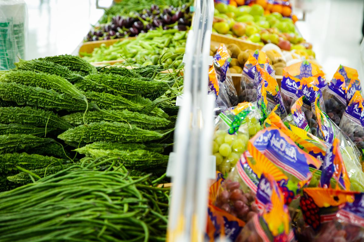 Two rows of produce at a grocery store.