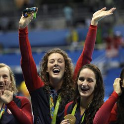 United States' Katie Ledecky, Allison Schmitt, Leah Smith and Maya DiRado, from left, during the women's 4 x 200-meter freestyle relay medals ceremony in the swimming competitions at the 2016 Summer Olympics, Thursday, Aug. 11, 2016, in Rio de Janeiro, Brazil.  Last week, Olympic swimmers Michael Phelps and Allison Schmitt both discussed their personal battles with depression.